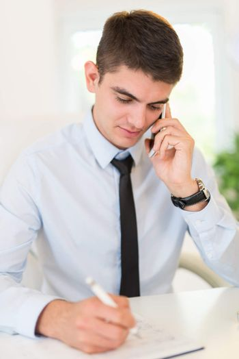 Businessman Phoning In Office