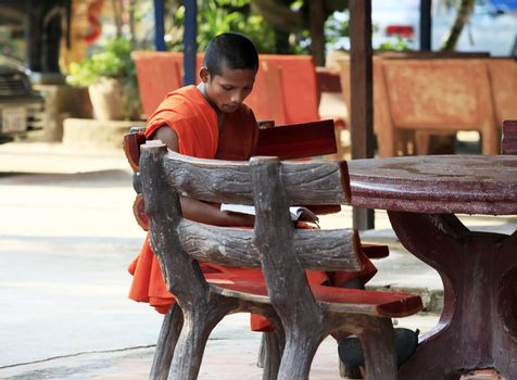 Siem Reap, Cambodia - April 07, 2014: Unidentified young monk of temple, Angkor Wat, Siem Reap on November 7, 2014, Cambodia.