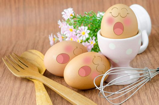 Eggs sleep with Expression Face in white cup and flower.