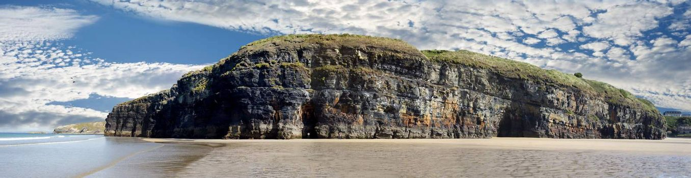 a panorama of the cliffs and beach on the wild atlantic way in ballybunion county kerry ireland