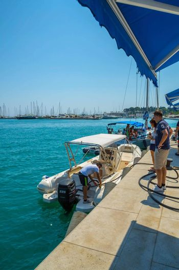 SPLIT, CROATIA - 19 JUL 2015: Boat refuels at a petrol station for ships and boats at the port