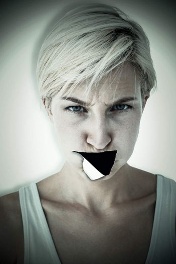 Composite image of angry woman looking at camera
