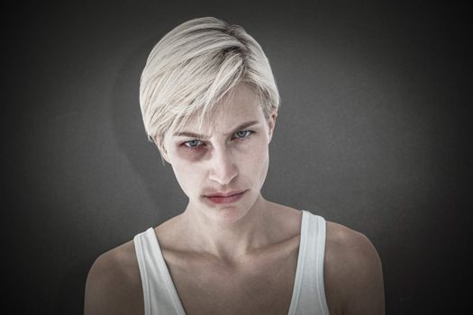 Composite image of upset woman looking at camera