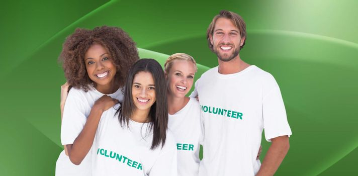 Smiling group of volunteers against abstract green design