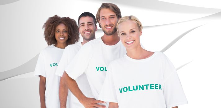 Smiling volunteer group against white wave design