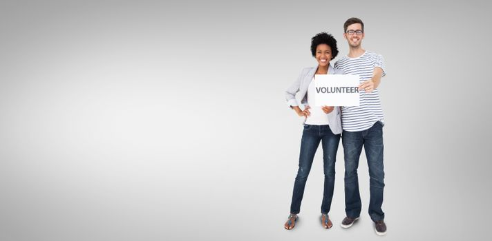 Composite image of portrait of a happy couple holding a volunteer note