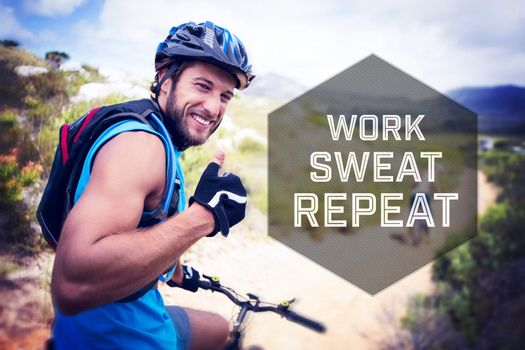 Motivational new years message against fit couple cycling on mountain trail man smiling at camera