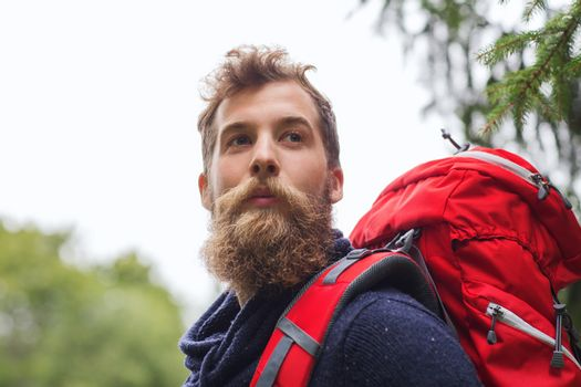man with beard and backpack hiking