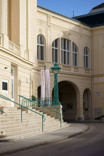 Baden, Austria - November 15, 2015: The Theater Square in the center of Baden with a passage and a staircase to the theater on November 15, 2015 in Baden near Vienna.