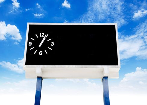 clock score board at football stadium