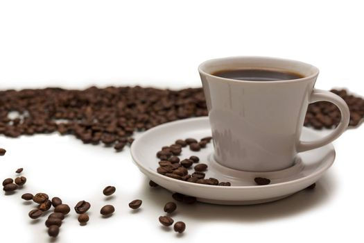 The photo shows a cup of coffee on a white background