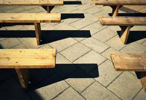 wooden benches on the pavement