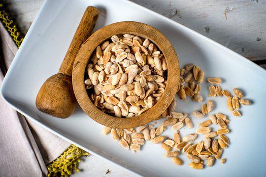 Bowl of fresh peanuts crushed ingredient