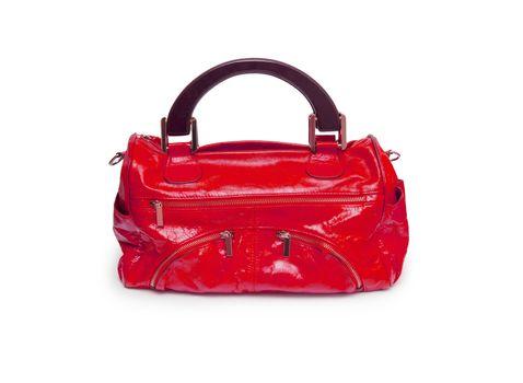 Red female handbag isolated on white background.
