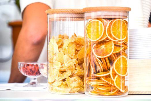 sugar lemon and orange slices in a clear jar