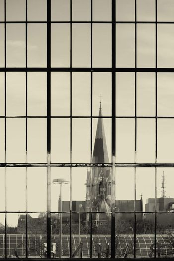 Behind the panoramic windows of a train station is a church to see.