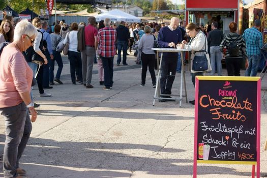 Mainz, Germany - October 02, 2015: Teenage viewers and visitors standing on food stalls and bistro tables from various regional providers on October 02, 2015 in Mainz.