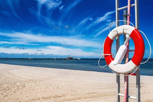Lifebuoy on sandy beach