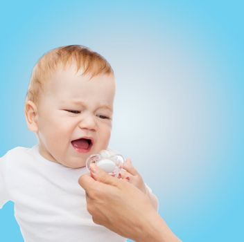 crying baby with dummy