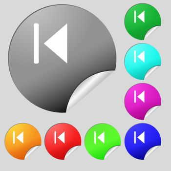 fast backward icon sign. Set of eight multi-colored round buttons, stickers.