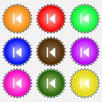 fast backward icon sign. A set of nine different colored labels.