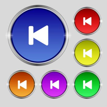 fast backward icon sign. Round symbol on bright colourful buttons.