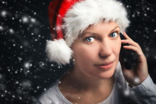 Woman talking on the mobile phone on Christmas eve