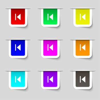 fast backward icon sign. Set of multicolored modern labels for your design.