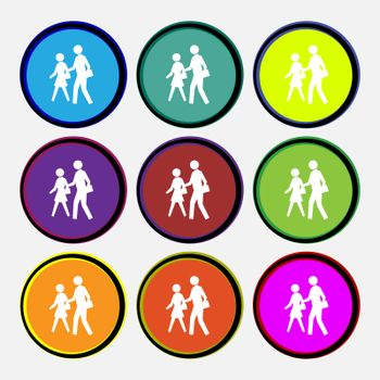 crosswalk icon sign. Nine multi colored round buttons.