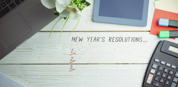 New years resolution list against overhead view of an desk