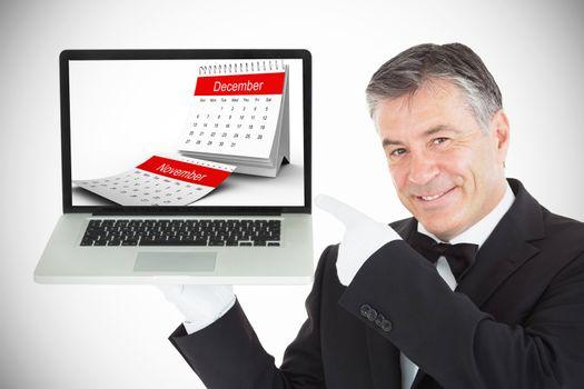 Composite image of desk calendar showing december