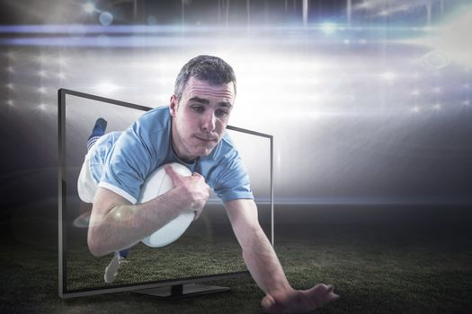Composite image of a rugby player scoring a try