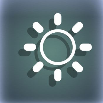 Brightness icon sign. On the blue-green abstract background with shadow and space for your text.