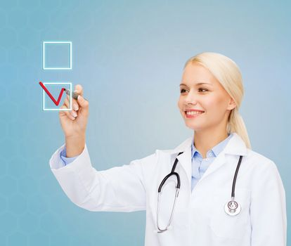female doctor drawing mark to check box