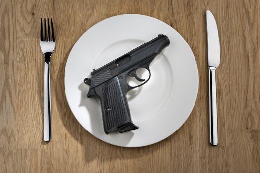 pistol on plate