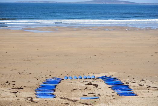 surf boards on the beach in ballybunion ready for a surf schools lessons
