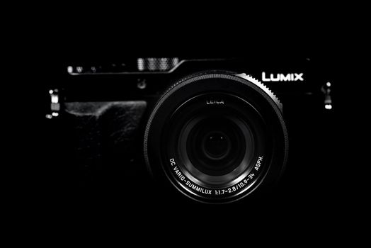 NOVI SAD, SERBIA - DECEMBER 1, 2015: Lumix DMC LX100, prosumer compact camera announced by Panasonic on September 15, 2014 with Leica-branded lens, can record 4K video. Illustrative editorial content, selective focus.