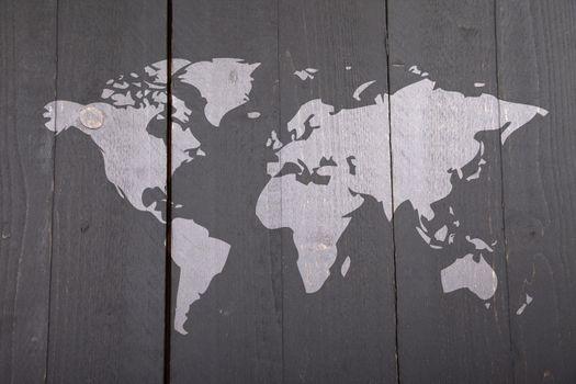 World map on dark black wooden background