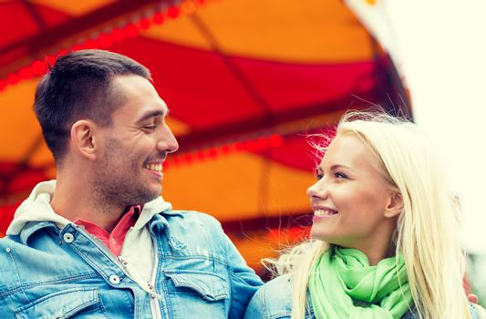 smiling couple in amusement park