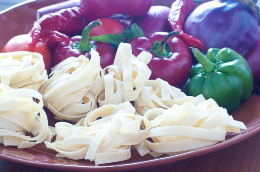 """Typical Italian pasta called """" noodles """" with hot peppers and to"""
