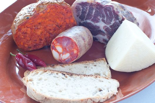 Typical salami and cheeses Calabrian brawn , ham , salami , n'du