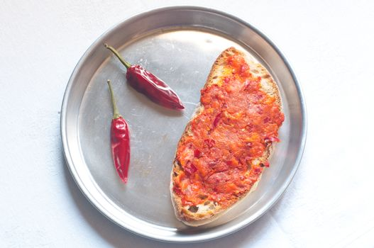 Bruschetta bread with spicy calabrese salami nduja