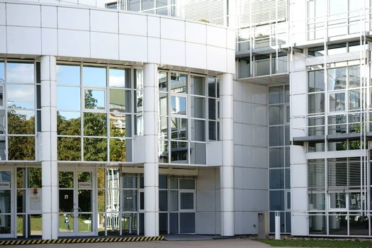 Mainz, Germany - September 26, 2015: The modern building and the main entrance of the Max Planck Institute for Polymer Research on the campus of the Johannes Gutenberg University on September 26, 2015 in Mainz.