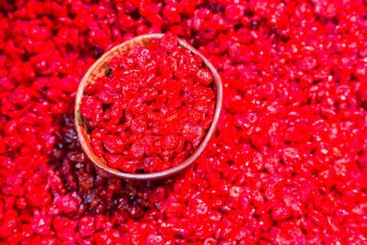 Scoop of dry cranberries.