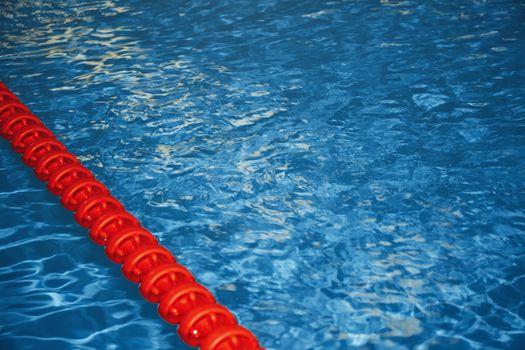 Swimming pool with lane markers. Horizontal photo