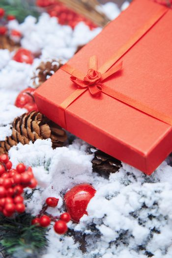 Christmas gift in a red box. Close-up vertical photo