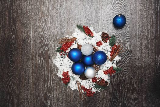 Christmas wreath and toys on a hardwood background