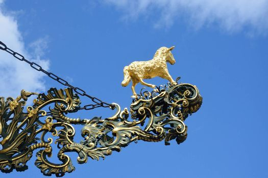 Golden lamb statue and sign