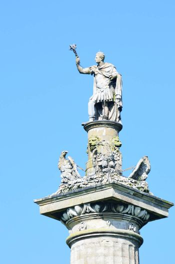 Statue of victory on top of column