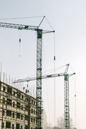 Industrial cranes on construction site